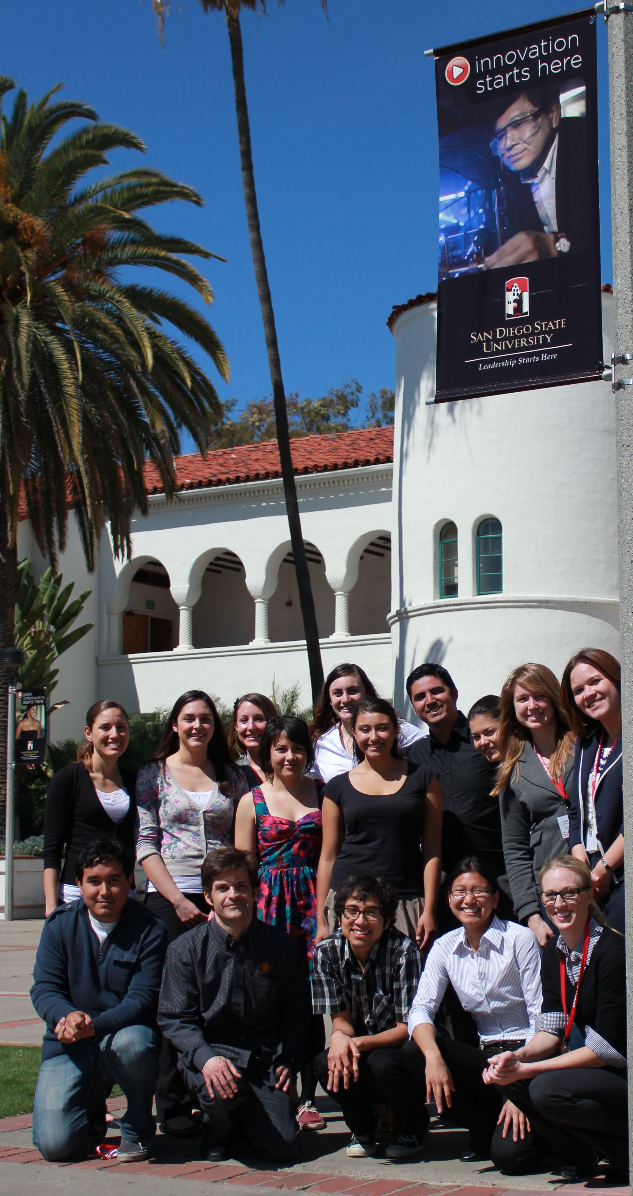 mbrs innovation group in front of hepner hall, Dr. Bill Tong poster overhead